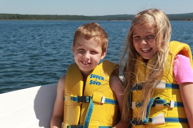 Kids in Life Jacket in Boat